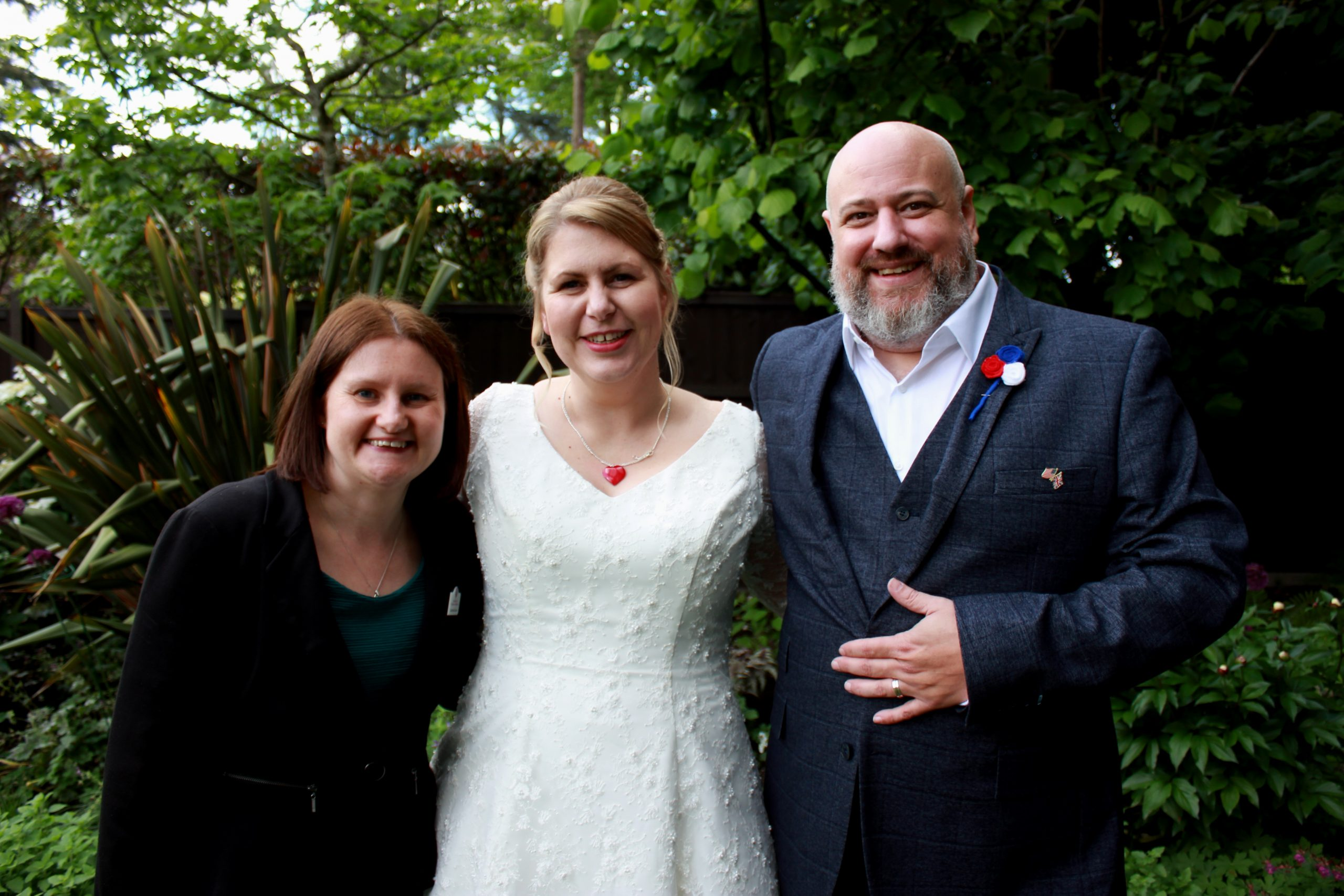 Celebrant with bride and groom