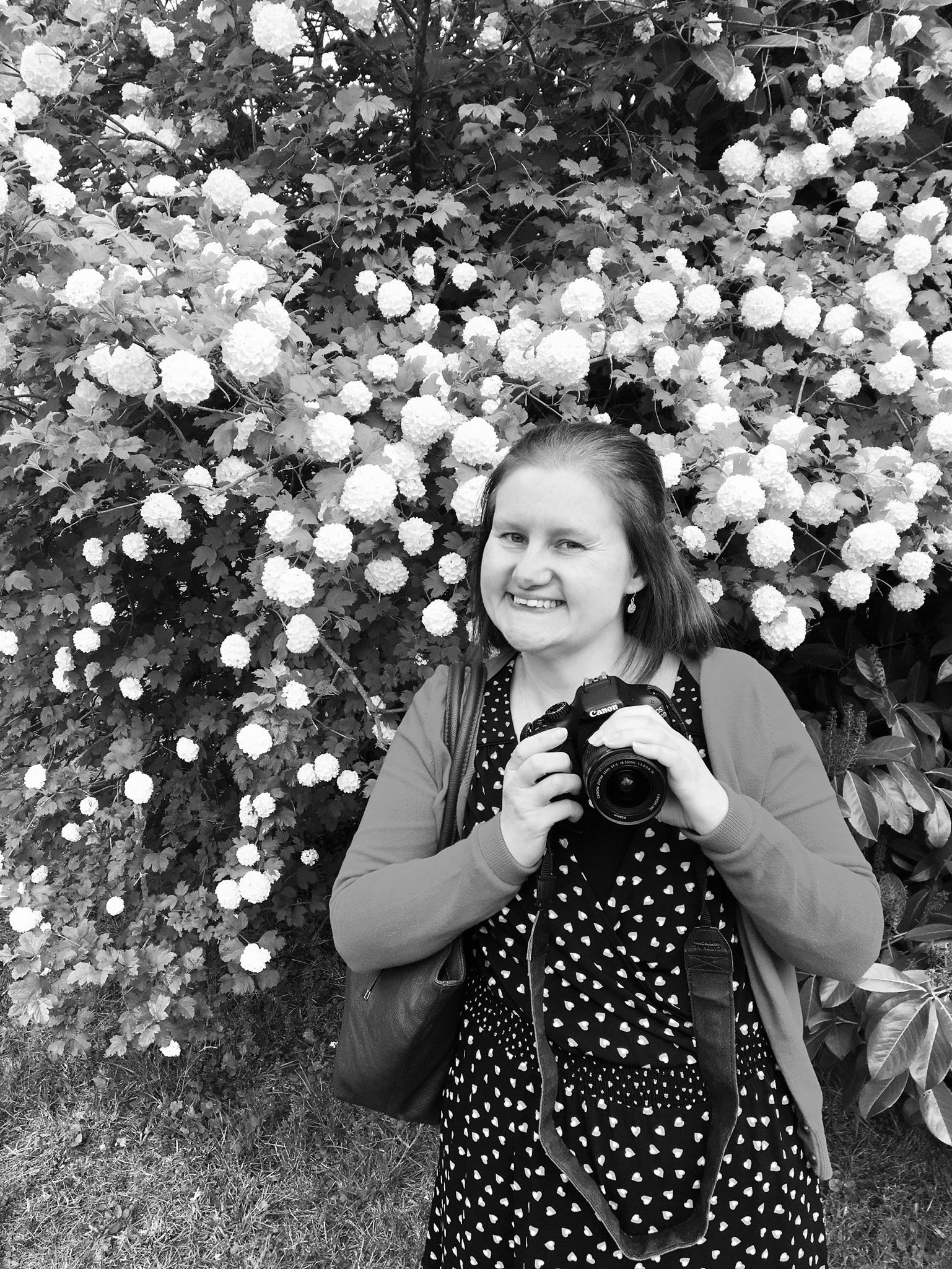 Samantha Dobson holding a camera