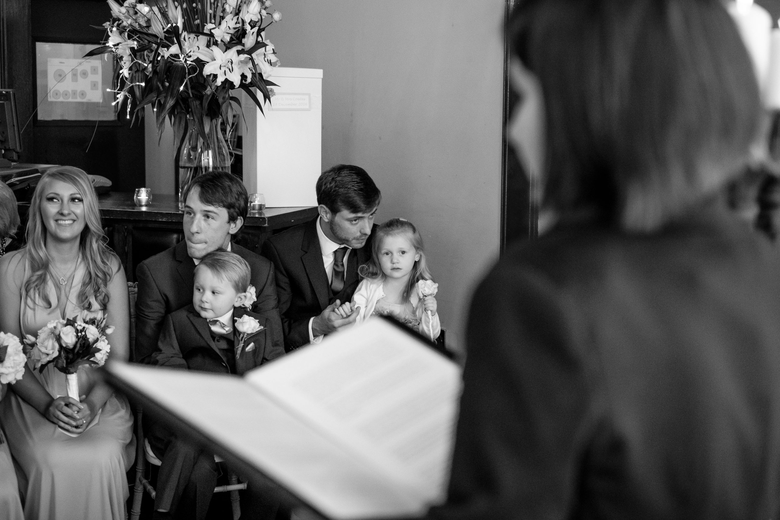 Celebrant conducting a wedding ceremony with bridesmaids looking on